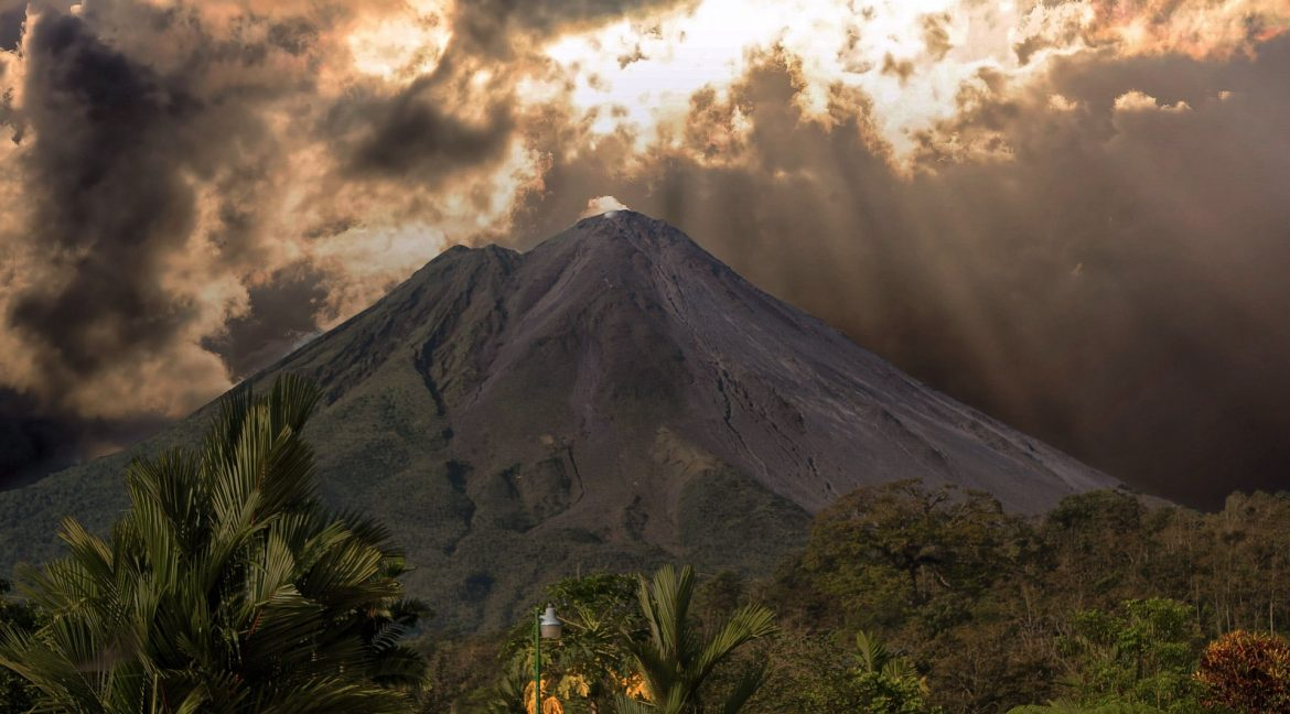 Arenal Volcano with sunbeams